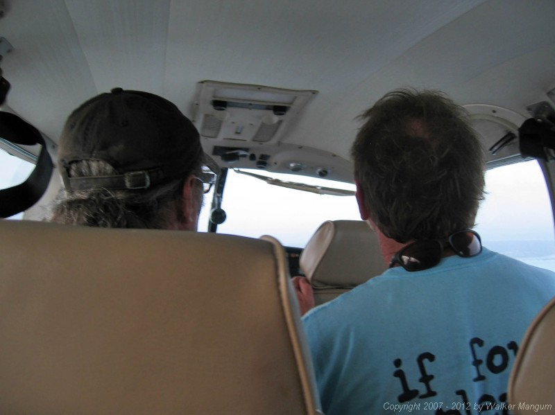 Flying into Anegada on Island Birds. The back of Davide and Walker's heads.