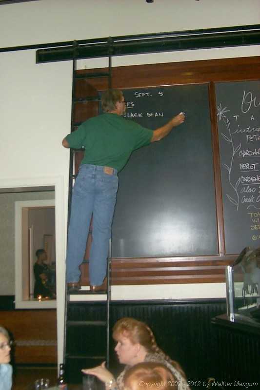 Walker writes the blackboard menu at Ouisie's.